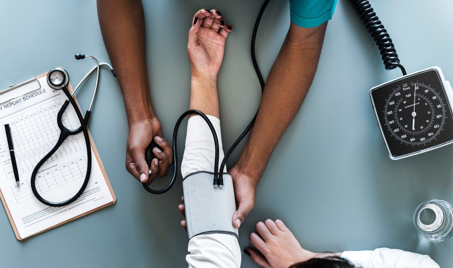 A nurse checking blood pressure.